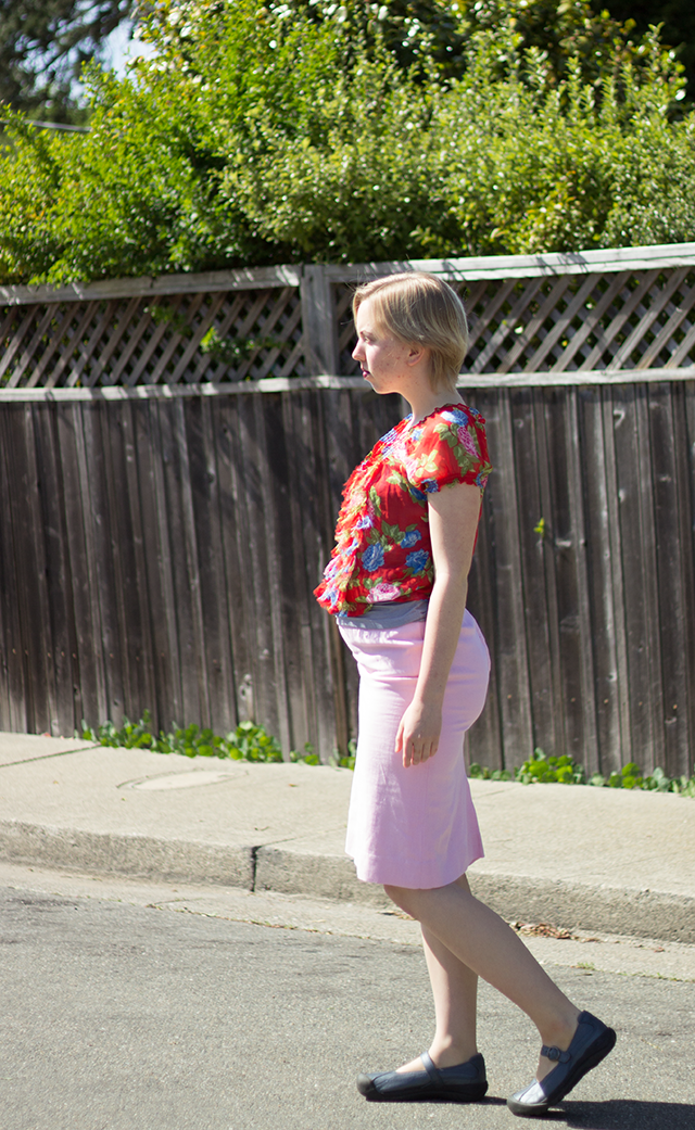 red floral blouse with ruffles, pastel pink pencil skirt