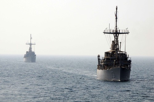 The mine countermeasures ship USS Sentry (MCM 3), left, and USS Dexrous (MCM 13) approach for an astern replenishment at sea