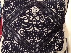 furniture(0.0), brown(0.0), purple(0.0), bed sheet(0.0), design(0.0), paisley(0.0), art(1.0), textile(1.0), throw pillow(1.0),