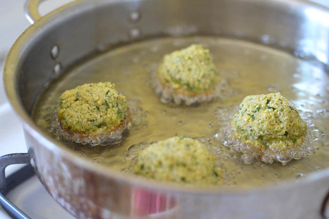 Fry homemade falafel in oil for several miutes on each side until golden brown.