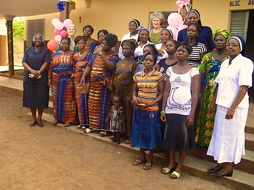 The new Mother and Child unit of the Centre De Santé St Louis d'Akpassi was officially opened in April 2013 by the Central Leadership Team. This photo shows the sisters and staff of the Akpassi Health centre workers standing outside the new extension