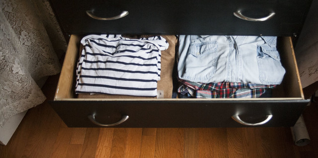 Little-blue-backpack-open-drawer-of-clothes