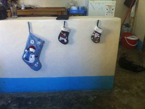 The stockings were hung on the wall with care