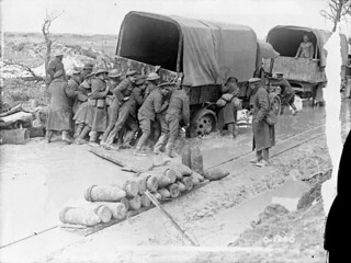 Canadians giving a truck a helping hand on a shell-battered road on Vimy Ridge, France / Des Canadiens aidant à désembourber un camion sur un chemin troué par les obus, crête de Vimy, France