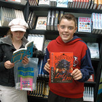 Young readers picking up new favourite reads in the bookshop |