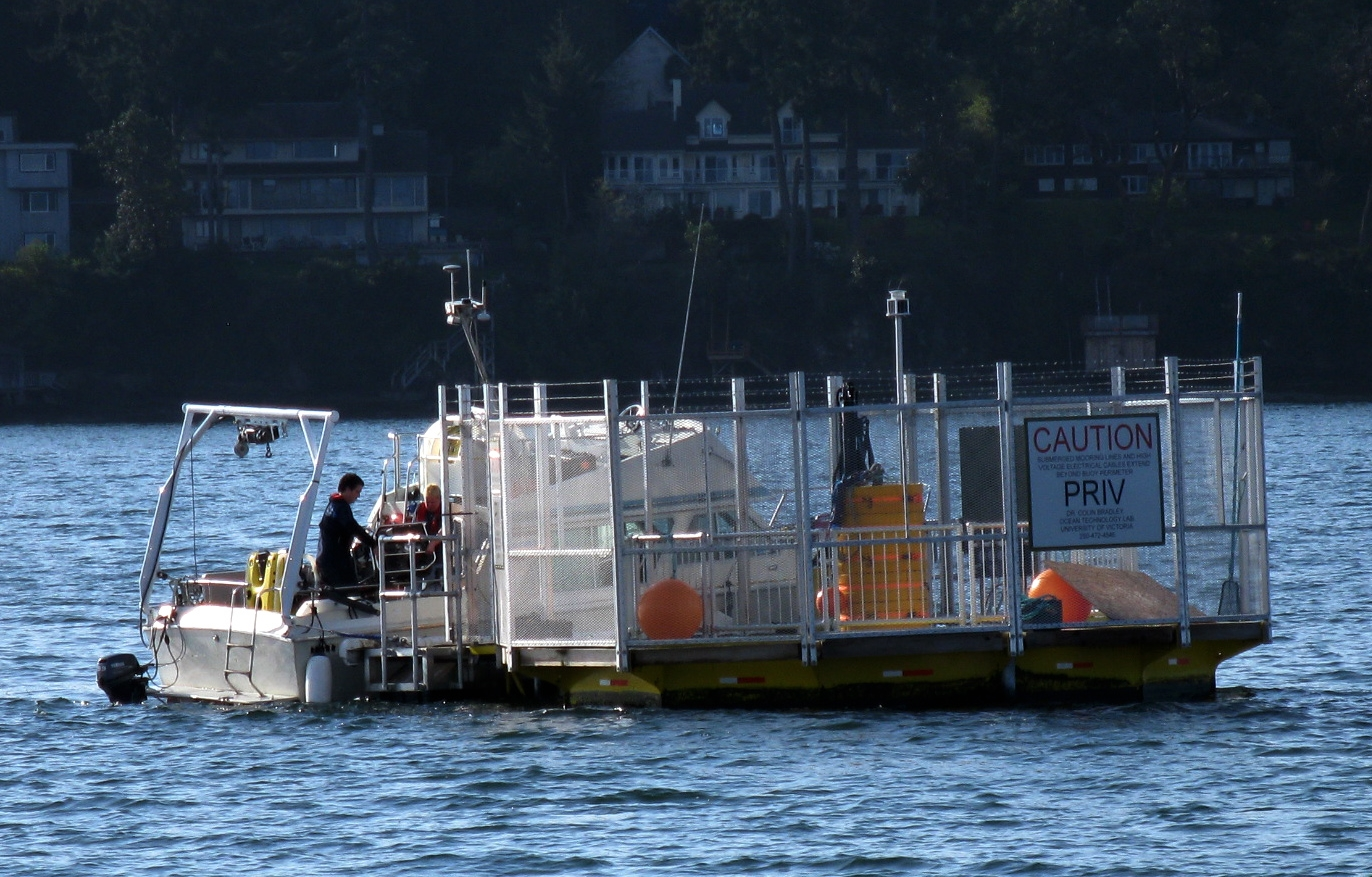 A small craft ties up next to the University of Victoria's Ocean Technology Test Bed (OTTB) buoy in Saanich Inlet, 19 April 2011.