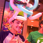 13-022 -- Jon Perko '15 sports a hat of twisted balloons at the Titan Carnival.