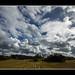 Åker, skyer og himmel