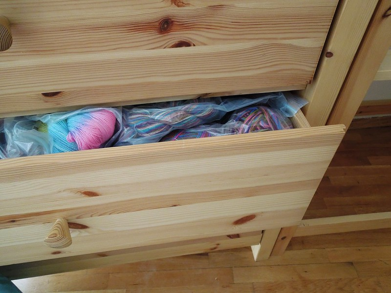 drawers stuffed with yarn
