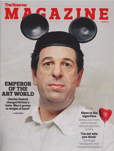 Charles Saatchi wears Mickey Mouse ears on the cover of a mag