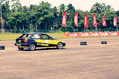 drifting(0.0), race car(1.0), auto racing(1.0), automobile(1.0), racing(1.0), sport venue(1.0), vehicle(1.0), stock car racing(1.0), sports(1.0), race(1.0), motorsport(1.0), rallycross(1.0), autocross(1.0), race track(1.0), sports car(1.0),