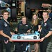 Tristan Vautier and Simon Pagenaud present owner Sam Schmidt a custom birthday cake in Baltimore