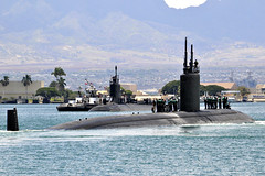 USS Tucson (SSN 770), foreground, passes USS Hawaii (SSN 776) as Tucson departs Joint Base Pearl Harbor-Hickam, Sept. 5. (U.S Navy photo by Mass Communication Specialist 2nd Class Steven Khor)