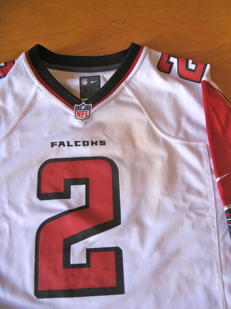 ... because the jersey was used in a Tide commercial that was shown during  last season's Super Bowl. Matt Ryan's name and number on the back.