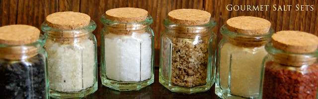 A set of fancy salts in glass jars