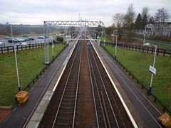 Greenfaulds station looking south west towards Glasgow. The station was opened on 15 May 1989 by British Rail with financial backing from what was then the Strathclyde Passenger Transport Executive. It is located  1 mile (1.6 km) south west of Cumbernauld, 13¼ miles (21 km) north east of Glasgow Que...