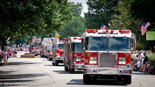 Lights and Sirens - the fire department is the best part of the parade by Jim Frazier