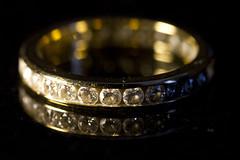 wedding ceremony supply(1.0), ring(1.0), yellow(1.0), jewellery(1.0), diamond(1.0), gold(1.0), circle(1.0), wedding ring(1.0),