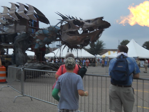 Very large metal sculpture sharped like a dragon breathing fire
