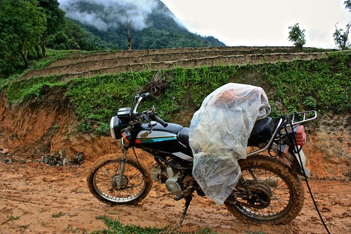 we helped push this motorbike up a steep muddy road