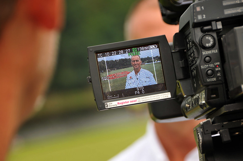 Professor of Entomology Rick Brandenburg gets some NewsChannel 14 camera time during Turfgrass Field Day.