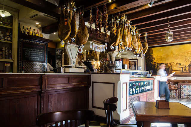 High quality jamon hangs from the rafters of Sevilla's Casa Roman.