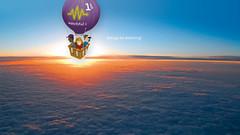 wing(0.0), parachuting(0.0), aircraft(1.0), aviation(1.0), horizon(1.0), hot air balloon(1.0), vehicle(1.0), hot air ballooning(1.0), reflection(1.0), air travel(1.0), sky(1.0), flight(1.0),