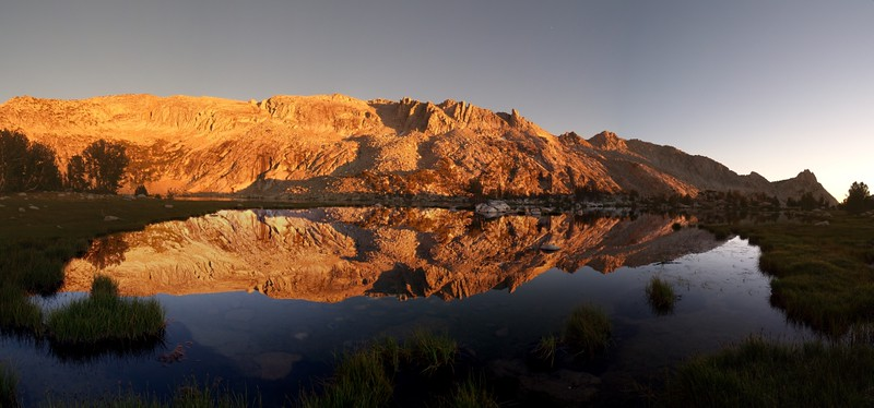 Panorama of sunset reflections on upper Young Lake, Ragged Peak on the far right