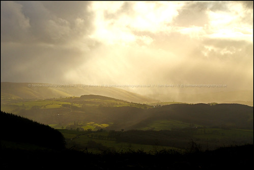 green rain clouds landscape countryside hills fields british welsh