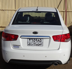 automobile(1.0), automotive exterior(1.0), vehicle(1.0), kia forte(1.0), kia cerato(1.0), mid-size car(1.0), bumper(1.0), sedan(1.0), land vehicle(1.0), vehicle registration plate(1.0), kia motors(1.0),