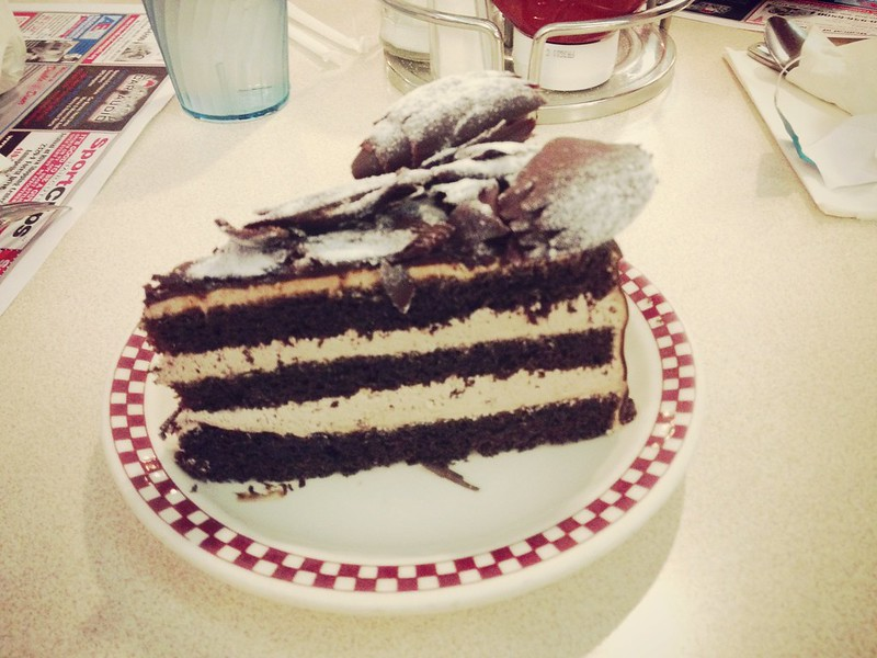 Chocolate layer cake with chocolate curls on top at 29 Diner in Arlington, VA
