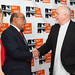 Dr. Mo Ibrahim shakes hands with Peter Gabriel on Red Carpet