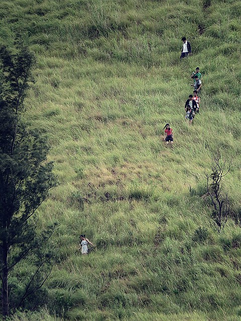 Hikers trailing down the steep side of mountain. Photographed by Bernard Eirrol Tugade