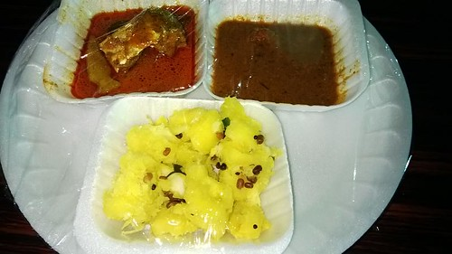 Kappa Puzhukku sold with Meen Curry and Rasam during a Food Festival in Trivandrum, Kerala, India