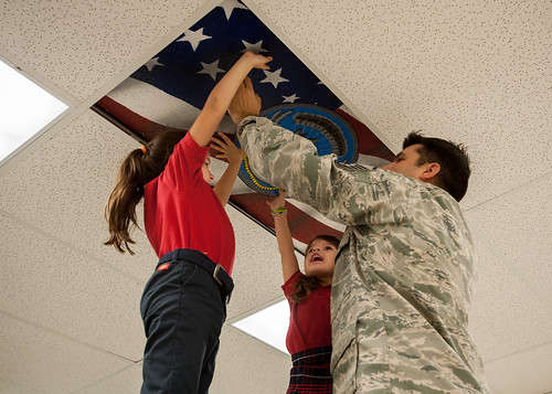 Daughters help create cieling art to depict 123rd Special Tactics Squadron mission