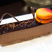 Earl grey mousse and chocolate cake with blood orange macaron