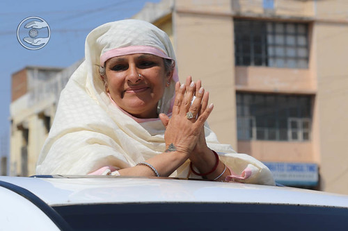 Her Holiness in open car