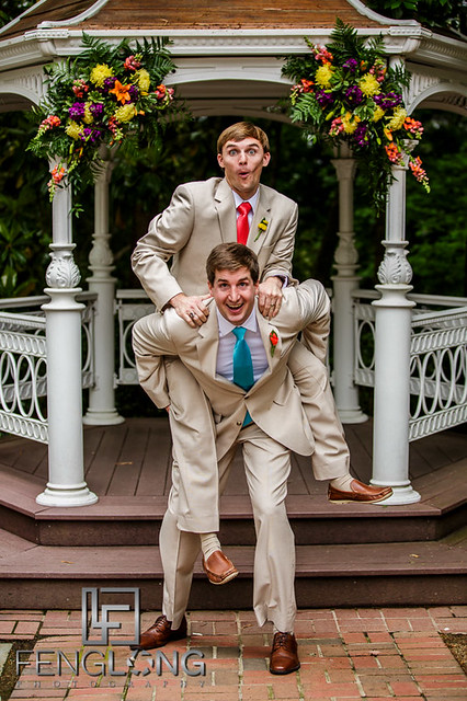 Groom and groomsman take funny photos together
