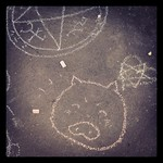 Obligatory piggy and occult symbols - chalk drawings at #sarjakuvafestivaalit