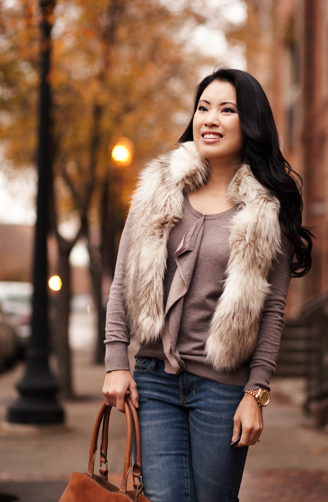 cute & little blog | fur vest, ruffle top, gap always skinny jeans, jessica simpson aggie boot, emilie m jane satchel outfit