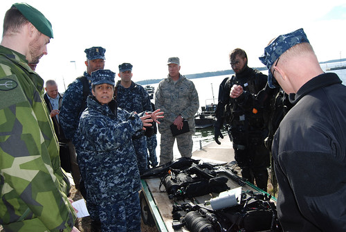 Mon, 04/03/2017 - 09:11 - 170403-N-N0901-009 HANINGE GARRISON, Sweden (April 3, 2017) Swedish military personnel and assault divers discuss their equipment with Adm. Michelle J. Howard, commander, U.S. Naval Forces Europe-Africa, and Fleet Master Chief Raymond D. Kemp during a visit to Haninge Garrison, April 3, 2017. U.S. Naval Forces Europe-Africa, headquartered in Naples, Italy, oversees joint and naval operations, often in concert with allied, joint, and interagency partners, to enable enduring relationships and increase vigilance and resilience in Europe and Africa. (Courtesy photo by Swedish Maj. Kristina Swaan/Released)