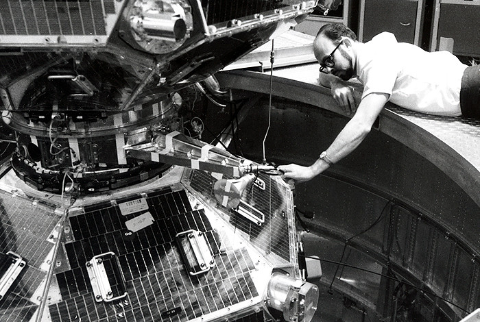 Los Alamos National Laboratory researcher Richard Belian performs a final check of the Vela V-B satellite prior to its launch in April 1970. Vela V-B was the last of the Vela twin satellites launched as part of a program to improve the United States' capability to detect, locate and identify nuclear explosions conducted in a variety of environments. Los Alamos is commemorating 50 years of space-based arms treaty verification efforts this month to coincide with the launch of the first Vela satellite on October 17, 1963. During the past 50 years, some 200 space vehicles have been launched with Los Alamos payloads aboard.