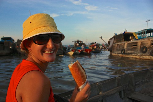 Lina enjoying fresh bread. Bought from a boat of course!