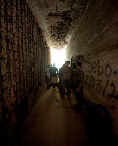 Marine Corps humanitarian assessment survey team members enter an abandoned bunker adjacent to the World War II battle site Bonn