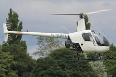 G-SUMX - 2001 build Robinson R22 Beta, arriving at Barton