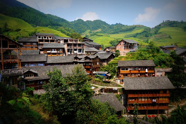 A scenic view of the town of Ping'An with rice terraces in the distance. (Guangxi, China)