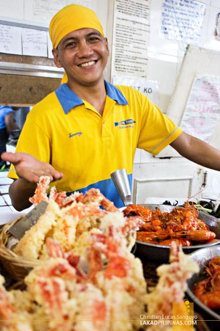 Serving at Aling Tonya's Seafood Dampa in Macapagal