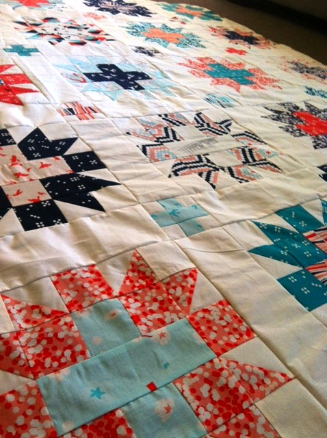 Star-crossed quilt top