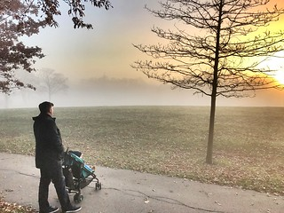 Father and Son watch the sunset in Greenhead Park, Huddersfield