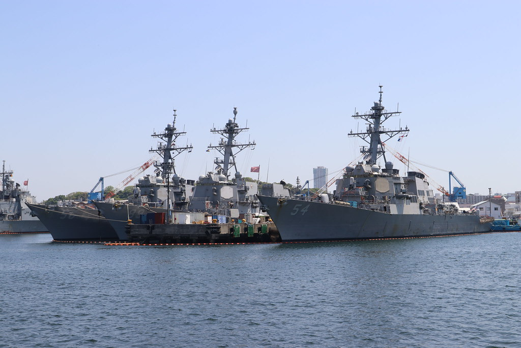 DDG-56 USS John S. McCain , DDG-89 USS Mustin , DDG-54 USS Curtis Wilbur